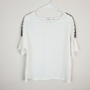 Calvin Klein Cream Jeweled Blouse.         A20-44